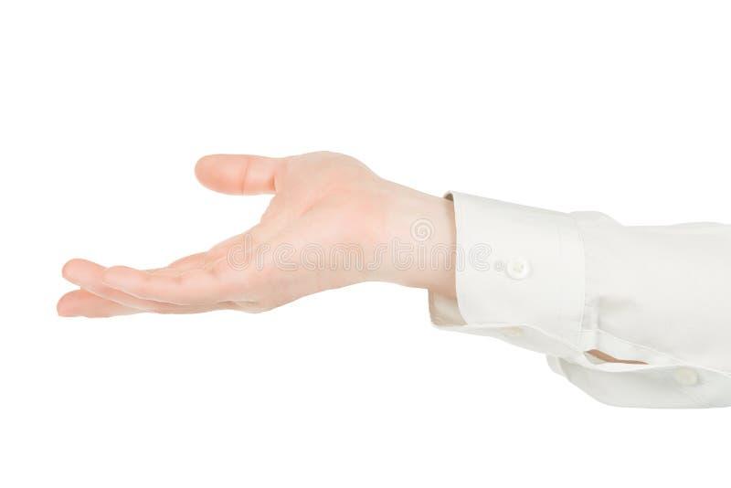 Les mains d'homme dans la chemise blanche tenant quelque chose ont isolé avec le chemin de coupage photographie stock