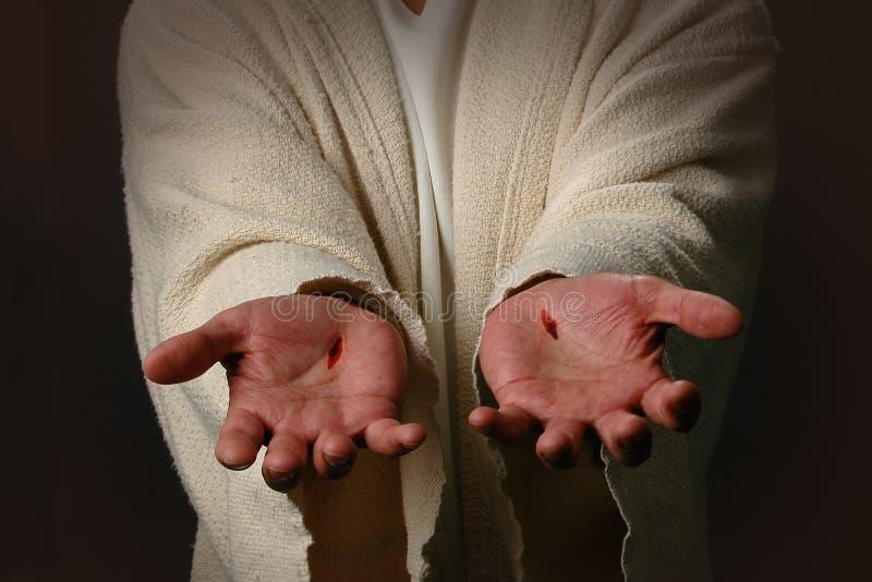 Les mains de Jésus photo stock