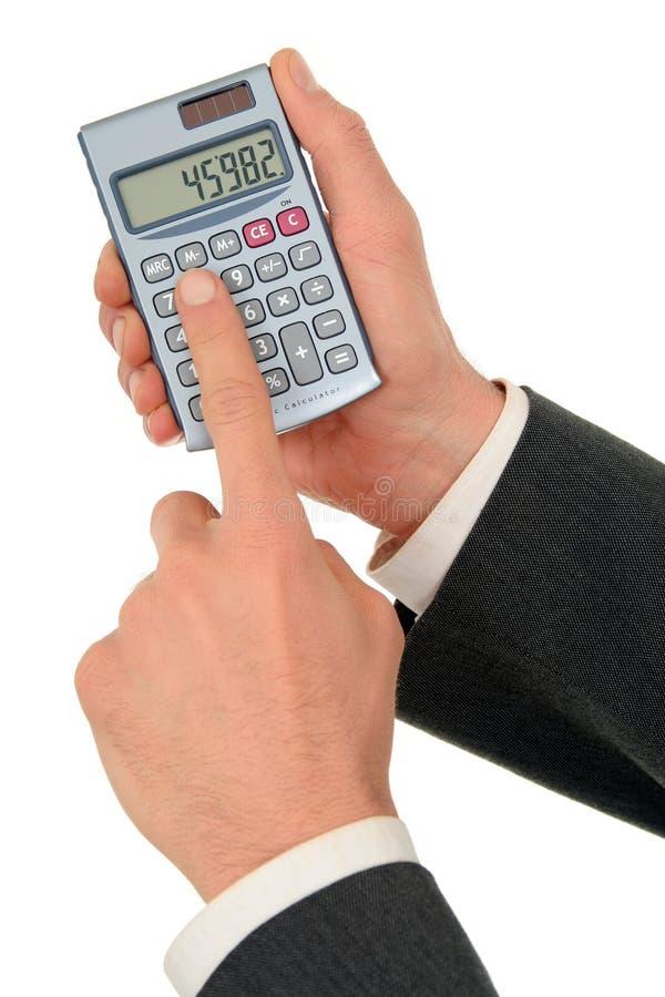 Les mains de l'homme d'affaires retenant une calculatrice photo libre de droits