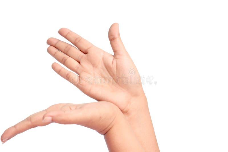 Les mains des femmes font quelque chose photos stock