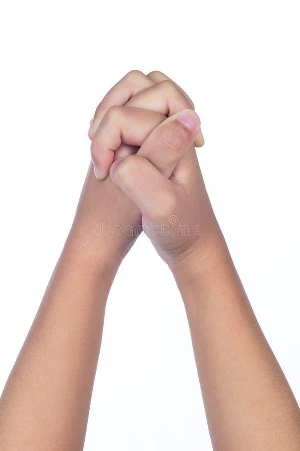Les mains du ` s d'enfant se sont pliées ensemble dans la prière images stock