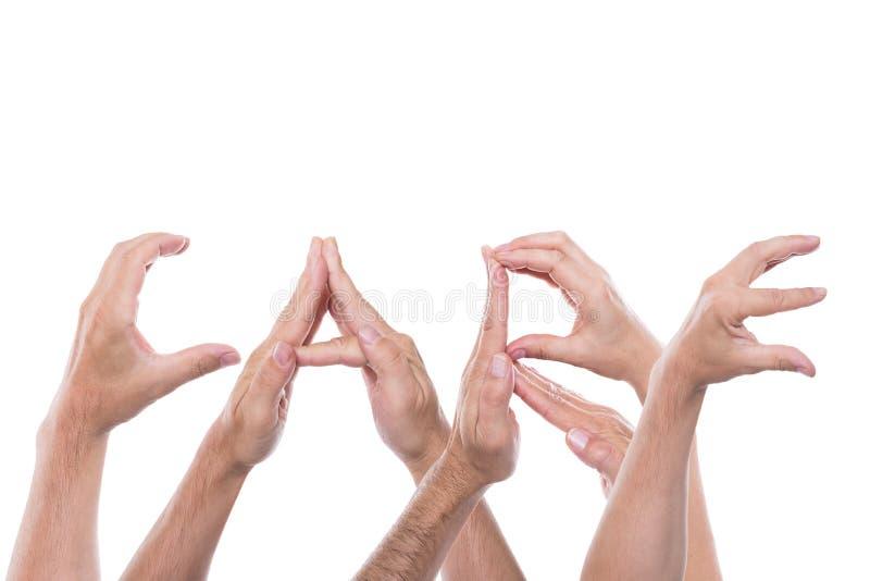 Les mains forment le soin de mot photos libres de droits