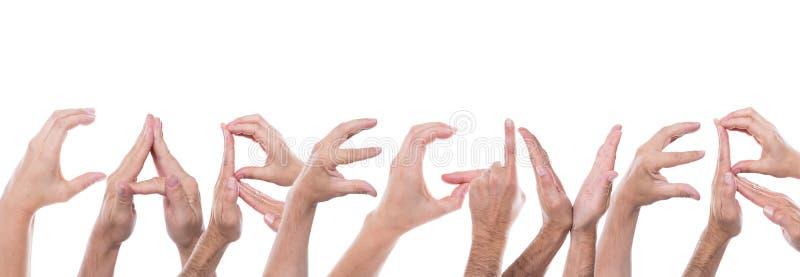 Les mains forment le travailleur social de mot photo libre de droits