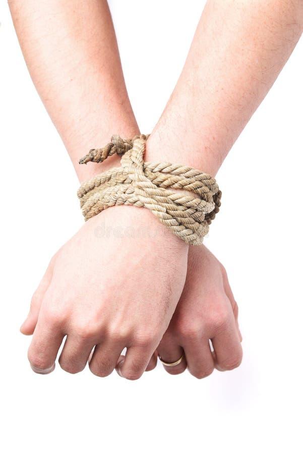 Les mains liées sur fond blanc, isolées Concept de limitation des droits de l'homme, arrestation images libres de droits