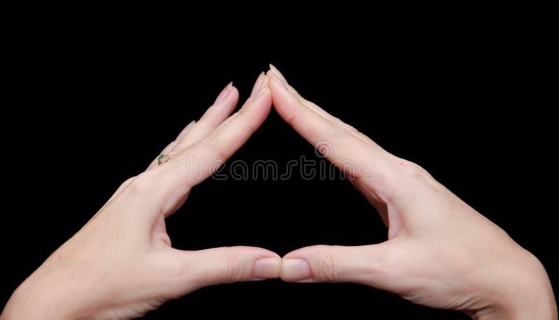 Les mains ont plié la triangle photo libre de droits