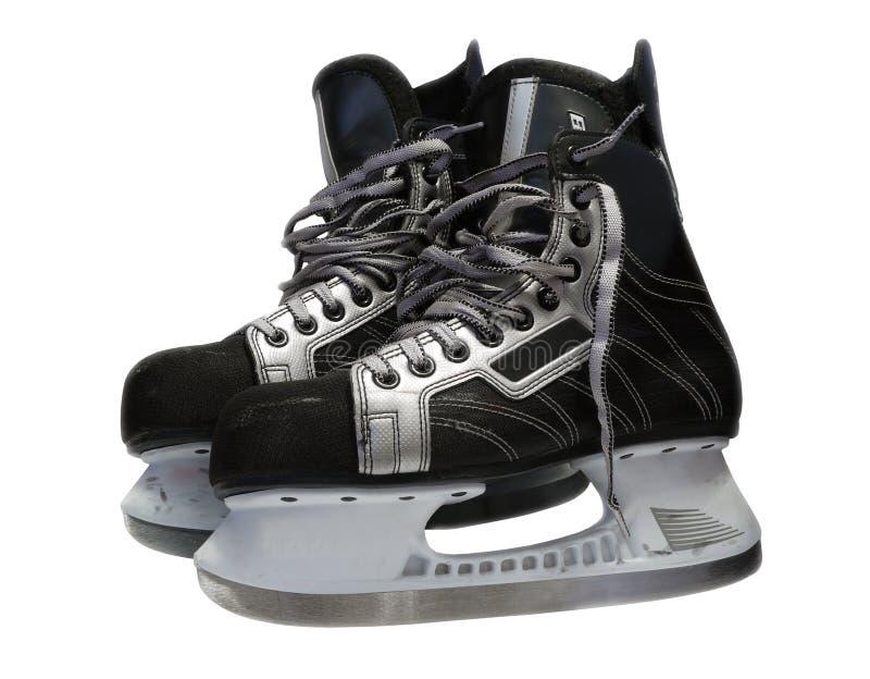 Les manies de glace-hockey au-dessus du blanc photographie stock