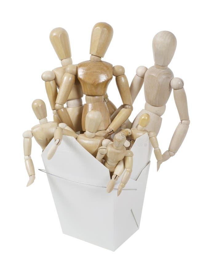 Les modèles en bois humains d'art dans une sortie enferment dans une boîte images libres de droits