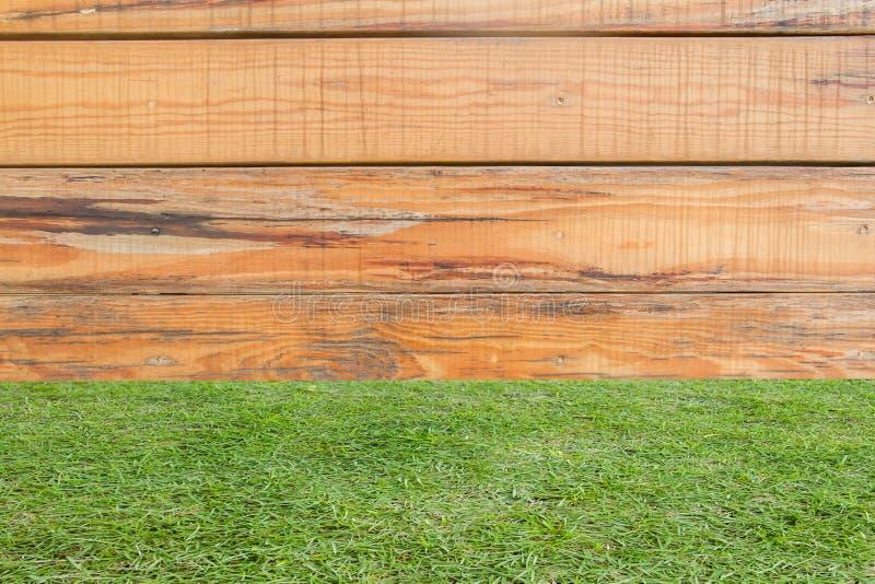 Les murs d'herbe et en bois sont disposé horizontalement fond images stock