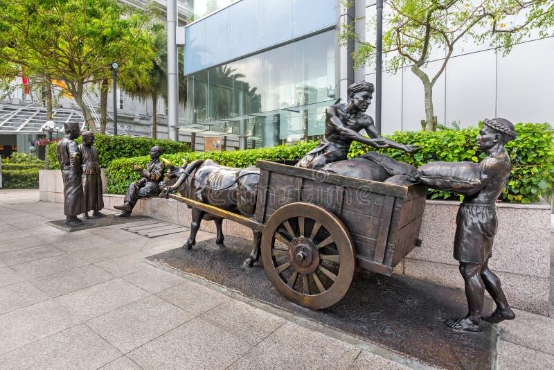 Les NÉGOCIANTS de RIVIÈRE, sculpture en bronze par la pièce en t Hong, Singapour d'aw photographie stock