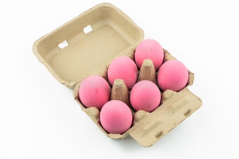 Les oeufs roses de siècle ou le paquet préservé d'oeufs de canard ont isolé photographie stock libre de droits