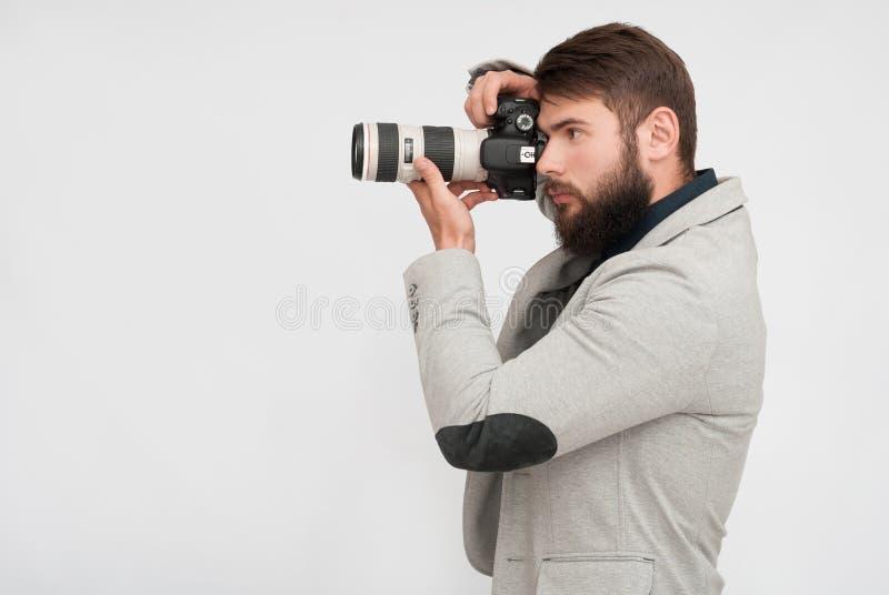 Les paparazzi équipent, photographe image stock