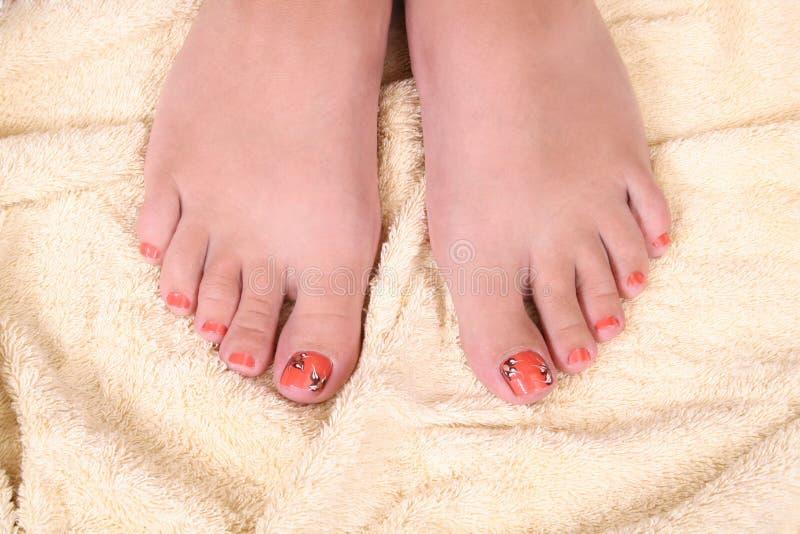 Les pieds du femme photos stock