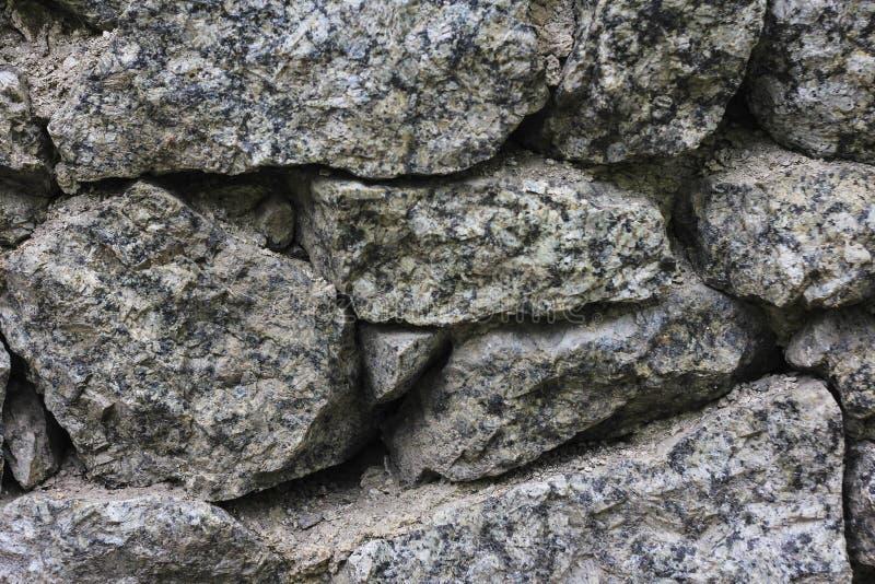 Les pierres donnent une consistance rugueuse et fond Oscillez la texture image libre de droits
