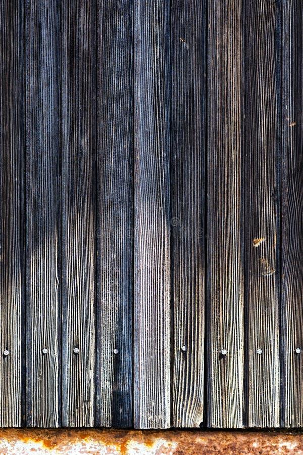 Les planches sont clouées exactement dans une rangée image libre de droits