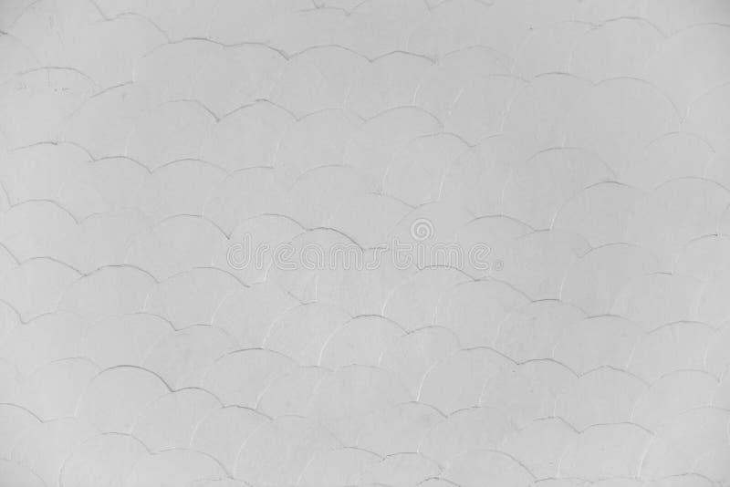Les poissons blancs pèlent le mur de peinture, fond, texture sans couture, bagout photo stock
