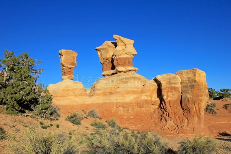 Les porte-malheur au ` s de diable font du jardinage, monument national grand d'Escalier-Escalante, Utah, Etats-Unis photographie stock libre de droits