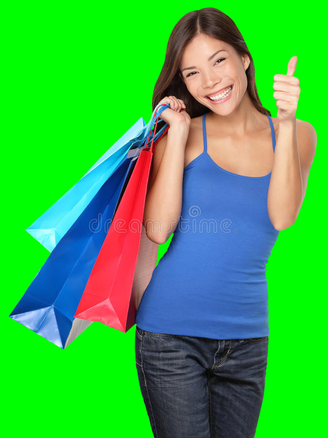 Les pouces de femme d'achats lèvent la réussite image stock
