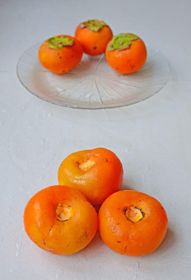 Les prestations-maladie du kaki porte des fruits avec des calories élevées mais des graisses très basses photographie stock