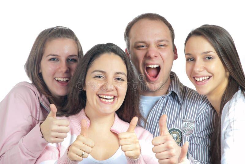 Les quatre jeunes affichant des pouces vers le haut photographie stock