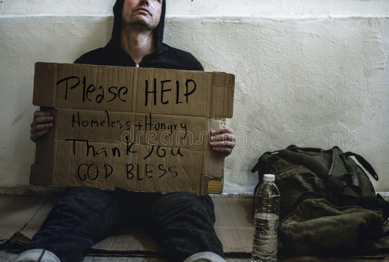 Les réclamations aident les personnes sans abri avec la faim photographie stock libre de droits
