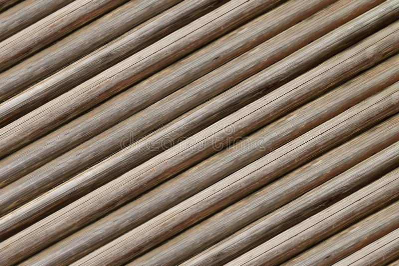 Les rondins minces de fond à nervures parallèle ont incliné bois superficiel par les agents par fond beige gris rustique de base  photo libre de droits