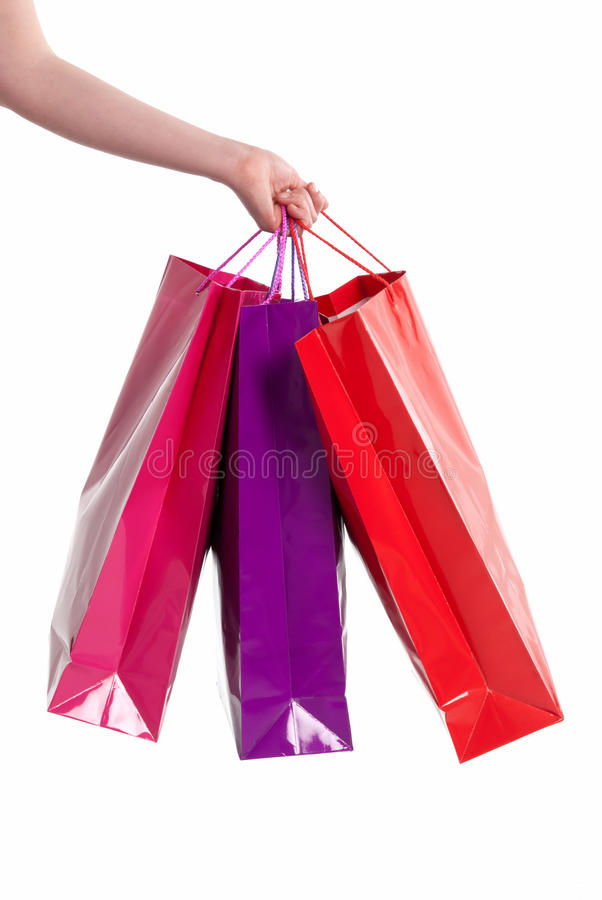 Les sacs à provisions femelles de fixation de main ont isolé images stock