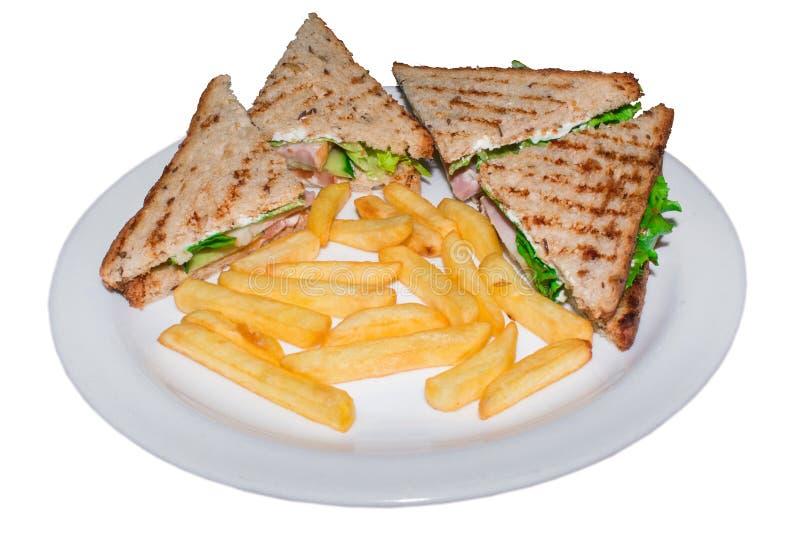 Les sandwichs au poulet très savoureux matraquent le mensonge d'un plat d'isolement images stock
