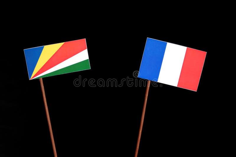 Les Seychelles diminuent avec le drapeau français sur le noir photos libres de droits