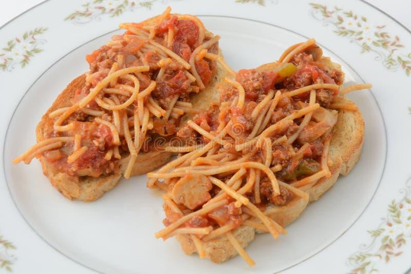 Les spaghetti serrent du plat image libre de droits