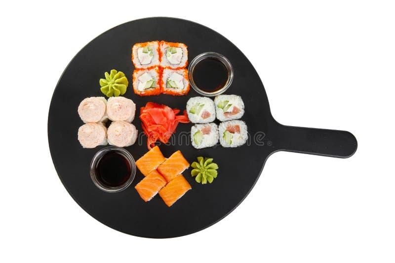 Les sushi, petits pains sur un blanc ont isolé le fond image stock