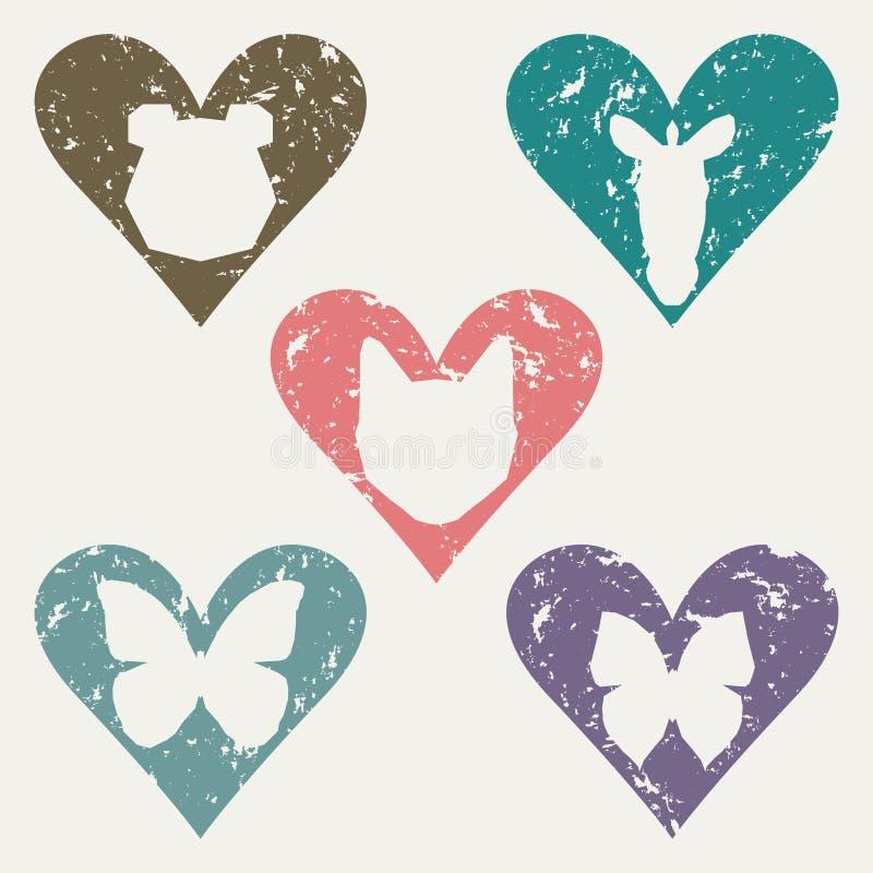 Les têtes animales dans le vieil ensemble de timbre de coeur pour l'usage dans la conception dans les matériaux et les travaux on illustration de vecteur