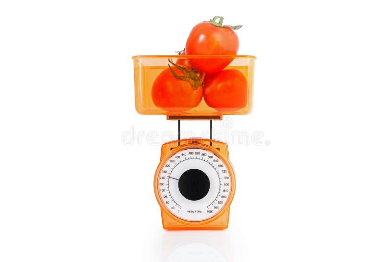 Les tomates sur l'échelle photo libre de droits