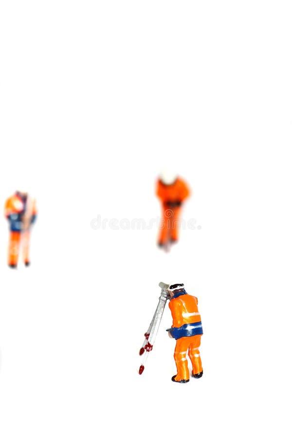 Les travailleurs modèles de construction ont isolé D photographie stock libre de droits