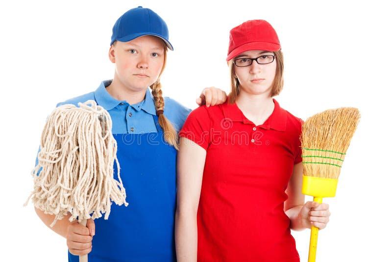 Les travaux de l'adolescence - ouvriers sérieux image stock