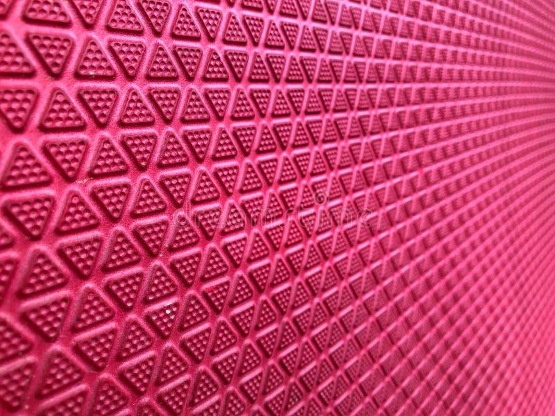 Les triangles rouges forment sans couture, résumé sur le rouge photo stock