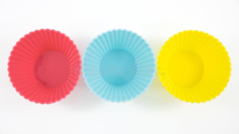 Les trois de tasses de cuisson de silicone photographie stock libre de droits