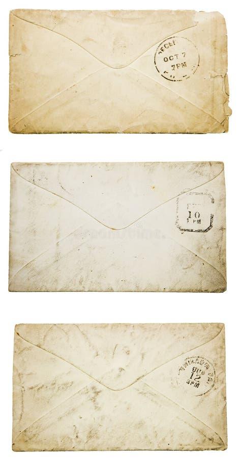 Les vieilles enveloppes vides soutiennent le collage sale usé de cachet de la poste photos stock