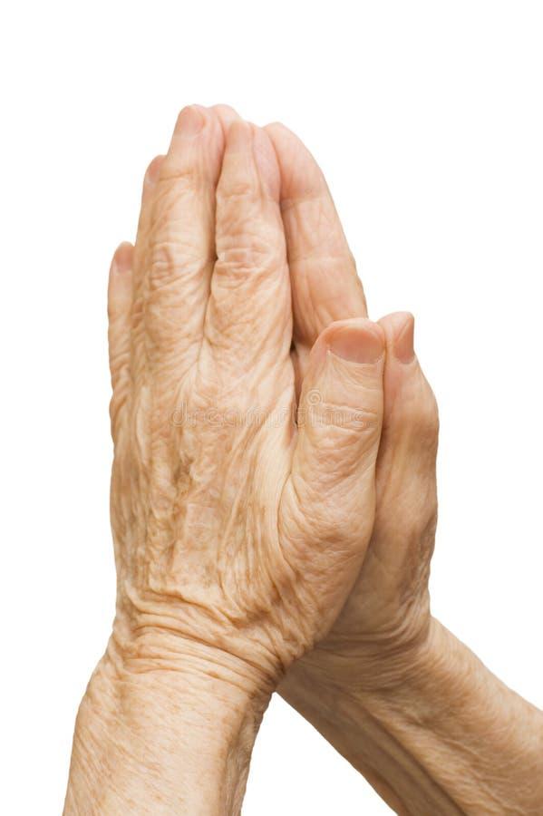 Les vieilles mains femelles prient photo stock