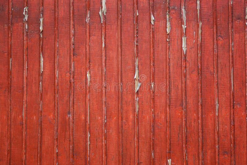 Les vieilles planches en bois minables avec la couleur criquée rouge peignent comme fond Texture de vieux conseils peints photographie stock libre de droits