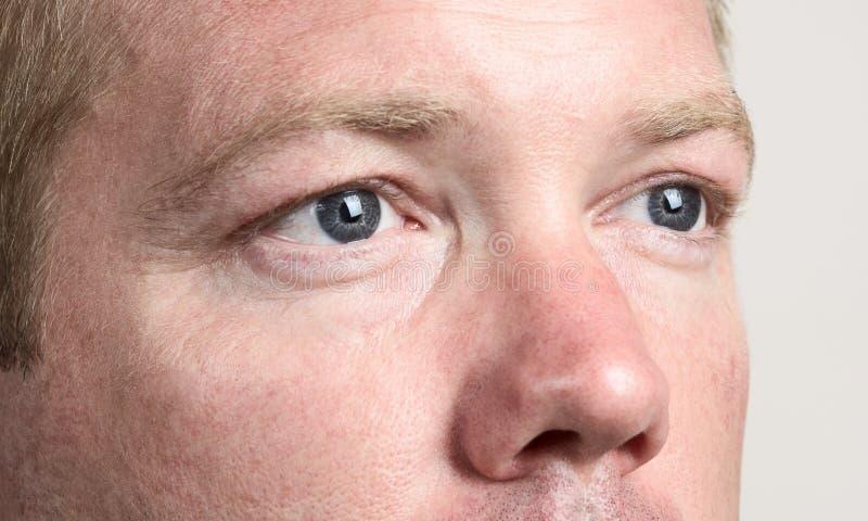 Les yeux de l'homme photos stock