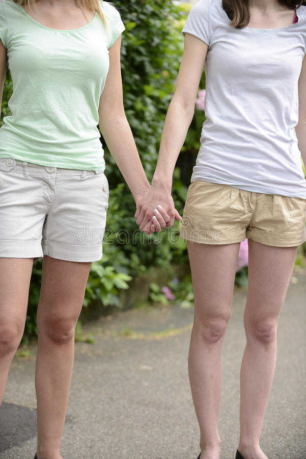 Lesbian couple holding hands royalty free stock photos
