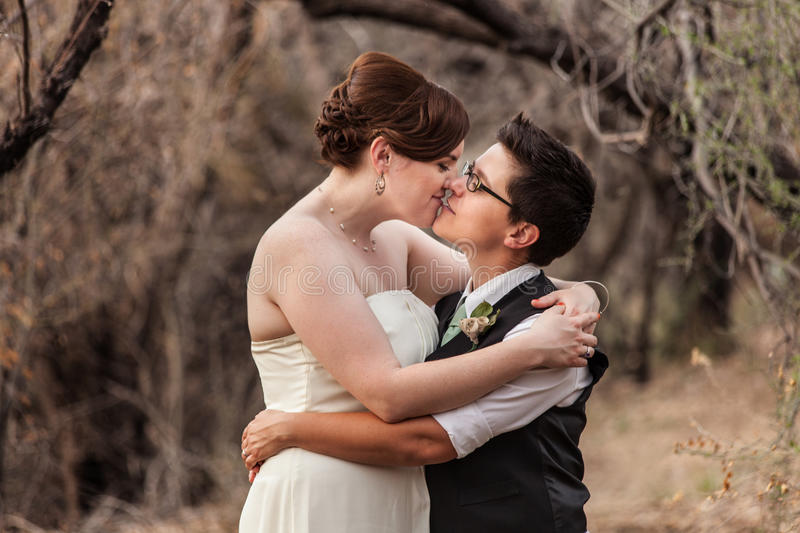 Lesbian Couple Kissing in the Woods stock images