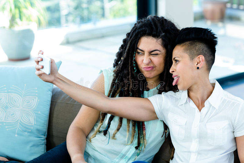 Lesbian Couple Taking A Selfie On Phone Stock Image