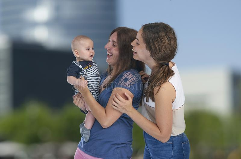 Lesbian love, young lesbian mothers with their baby. Homosexual royalty free stock image