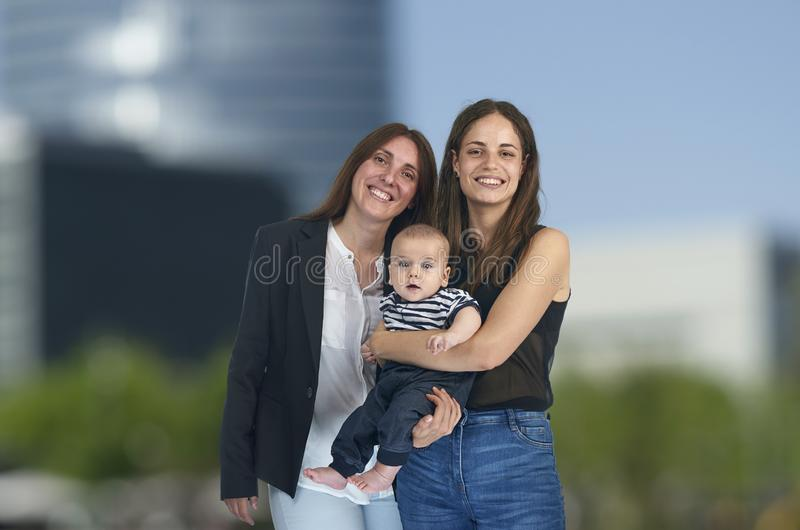 Lesbian love, young lesbian mothers with their baby. Homosexual royalty free stock images