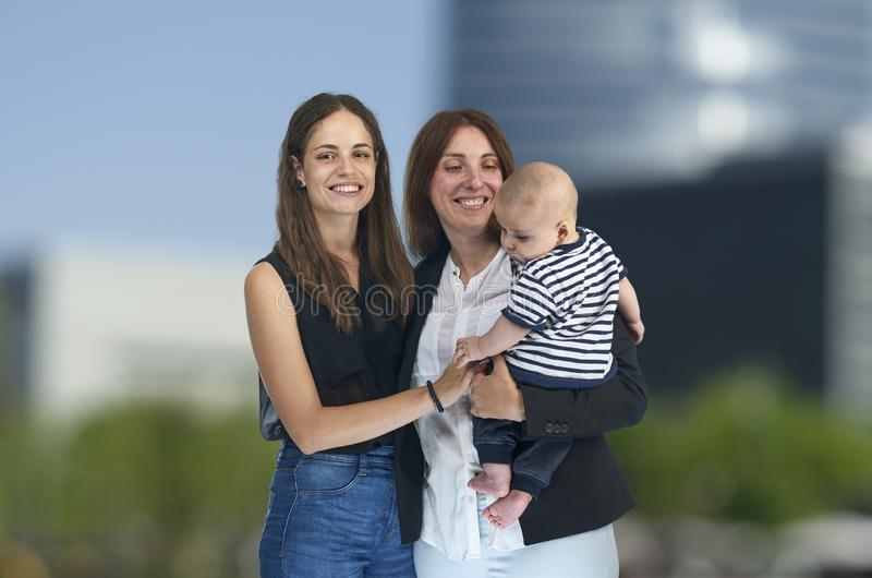 Lesbian love, young lesbian mothers with their baby. Homosexual stock photography