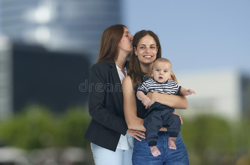 Lesbian love, young lesbian mothers with their baby. Homosexual royalty free stock photos