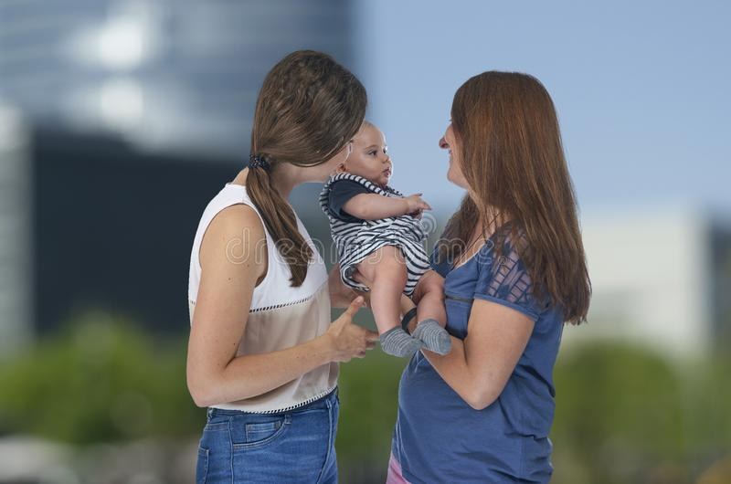 Lesbian love, young lesbian mothers with their baby. Homosexual stock photo
