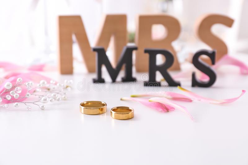Lesbian wedding accessories. On table stock photos