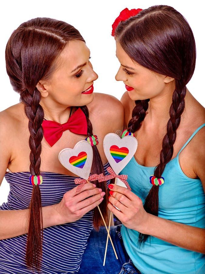 Lesbische vrouwen met gehoord in erotisch foreplay spel royalty-vrije stock foto's
